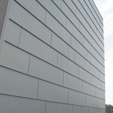 Rivestimento facciata in Rheinkink pre patinato, opera realizzata in collaborazione con l' azienda Polycoperture